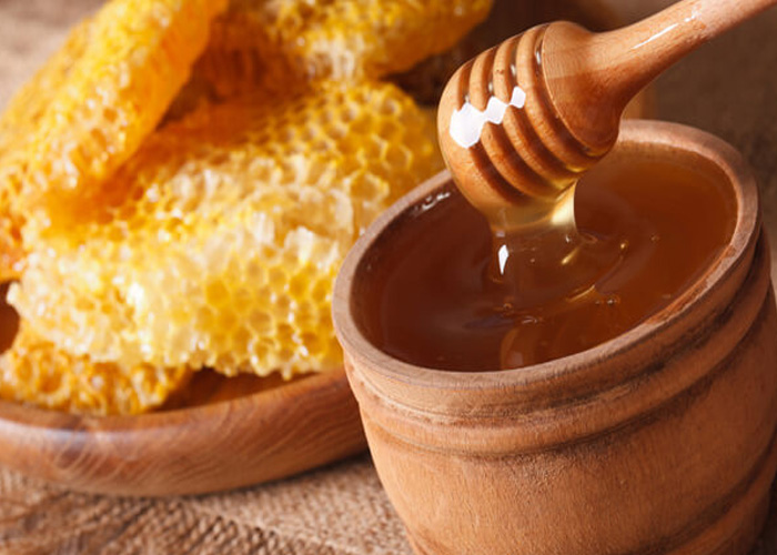 How does honey help a cough?